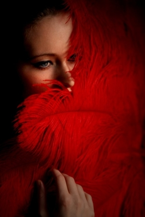 woman-red-ostrich-feather-fan